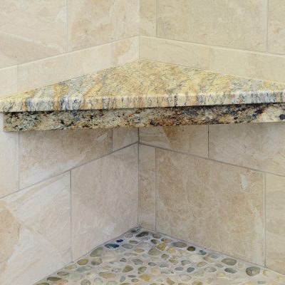 Granite shower bench in Capital Region bathroom remodel by Guidarelli Building and Design