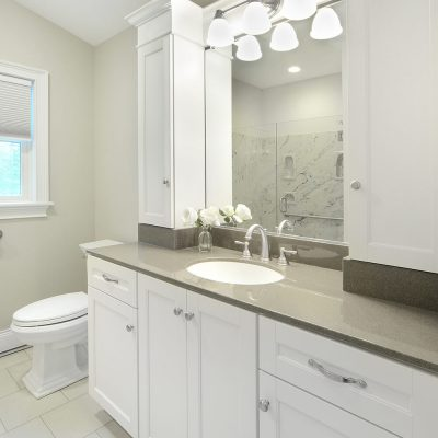 Custom vanity and storage cabinetry in bathroom renovation by Guidarelli, NY Capital Region
